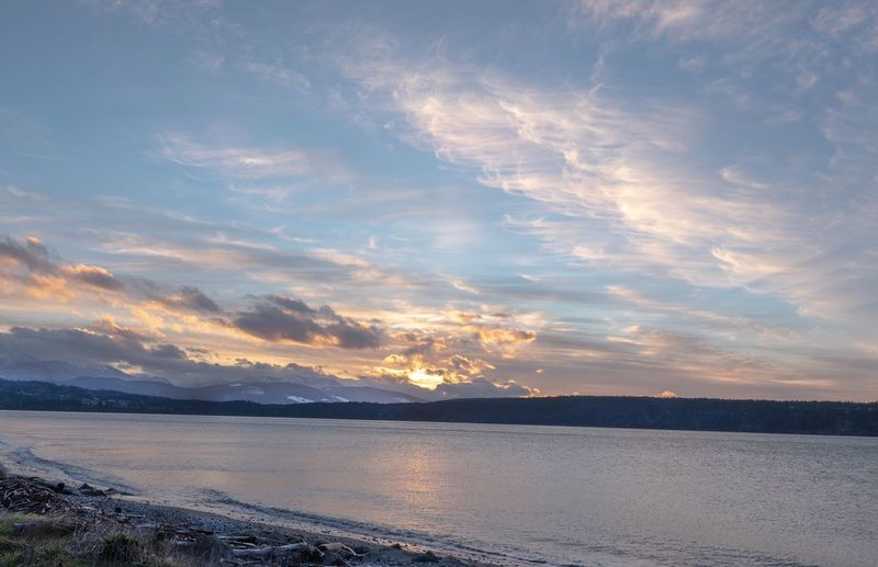 Landscape of clouds during sunset on Discovery Bay in Washington Washington State Clouds And Sky Cloudscape Sky Water Beauty In Nature Scenics - Nature Cloud - Sky Tranquil Scene Tranquility Waterfront Beach Mountain Land Non-urban Scene Outdoors Idyllic No People Nature Sea Sunset