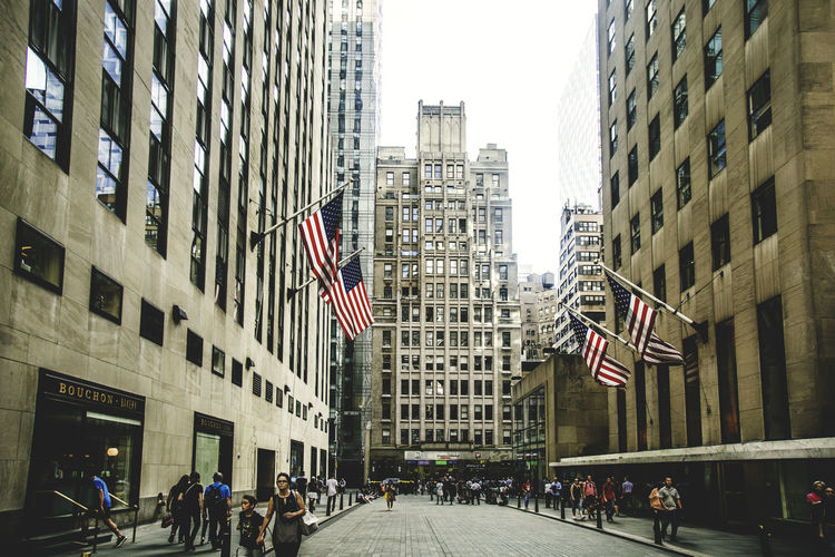 30 Rock Building Exterior City Architecture Built Structure Flag Building Patriotism Office Building Exterior Group Of People Real People City Life Day Skyscraper Street Office Outdoors Independence Travel Destinations Travel Photography Urban Urbanphotography Urban Landscape Cityscape City Street Crowd
