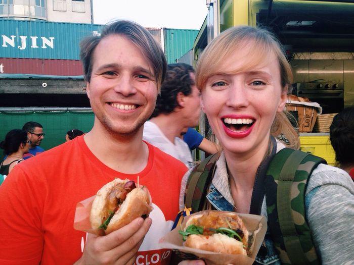 Smiling Couple Holding Hamburgers