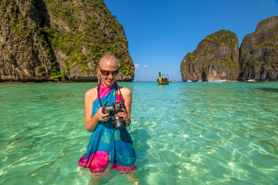 Back of happy and fashionable tourist woman with colorful sarong in turquoise water of Maya Bay famous lagoon of The Beach movie, Phi Phi Leh, Andaman Sea in Thailand Fashionable and happy tourist with sarong and pink wide-brimmed hat making a selfie on tropical famous beach of Nai Harn Beach, Rawai, Phuket, Thailand. Happy tourist enjoys panorama from Sail Rock View Point of kor 8 of Similan Islands National Park, Phang Nga, Thailand, one of the tourist attraction of the Andaman Sea. Happy woman with bikini and shorts, jumping in the air on Ya Nui Beach, a little cove divided by a rocky cape, Phuket, Thailand, Asia. Happy Koh Rok Islands Nui Beach Phang Nga Bay Phuket Thailand Tanning ☀ Thailand Vacations Woman Adventure Beach Beauty In Nature Day Front View Full Length Girl Koh Rok Leisure Activity Lifestyles Looking At Camera Nature Oar One Person Outdoors People Phang Nga Portrait Rawai Real People Rock - Object Scenics Sea Seascape Smiling Snorkeling Surin Islands Travel Destinations Vacations Water