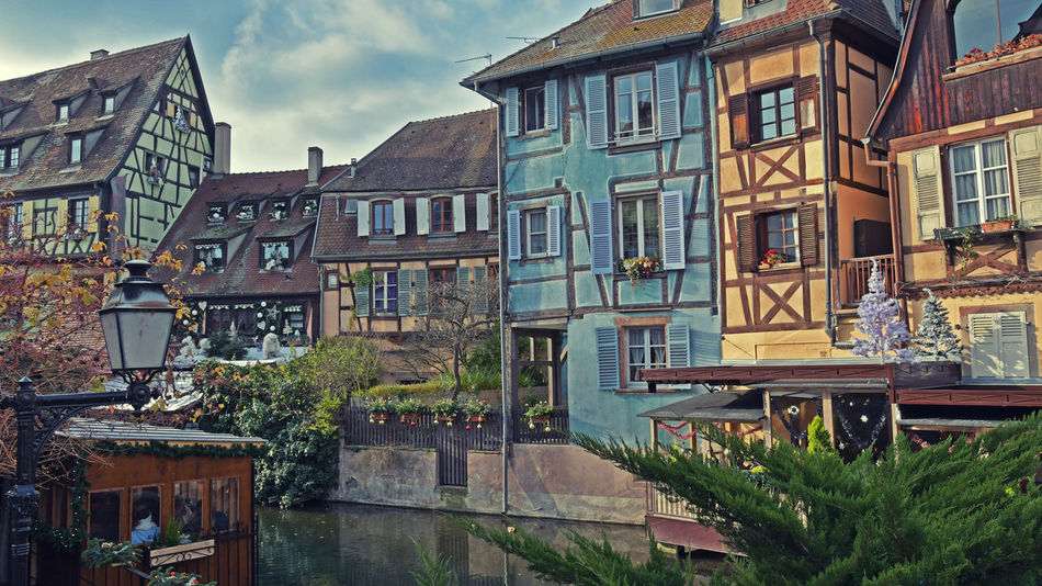 COLORS FOR A SUNNY CHRISTMAS DAY Alsace Colmar Colmar, Alsace, France France Streets Architecture Building Exterior Built Structure Day House Nature No People Outdoors Residential Building Sky Streetart Tree Water Window