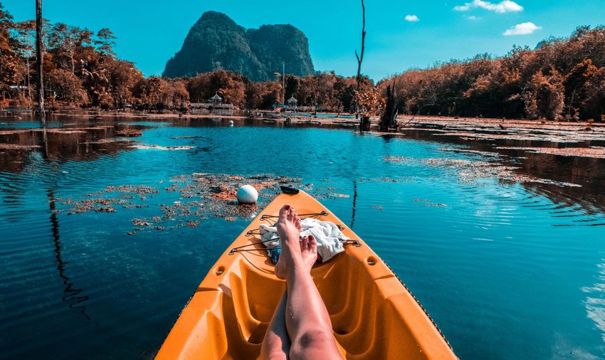 Low section of woman relaxing in boat
