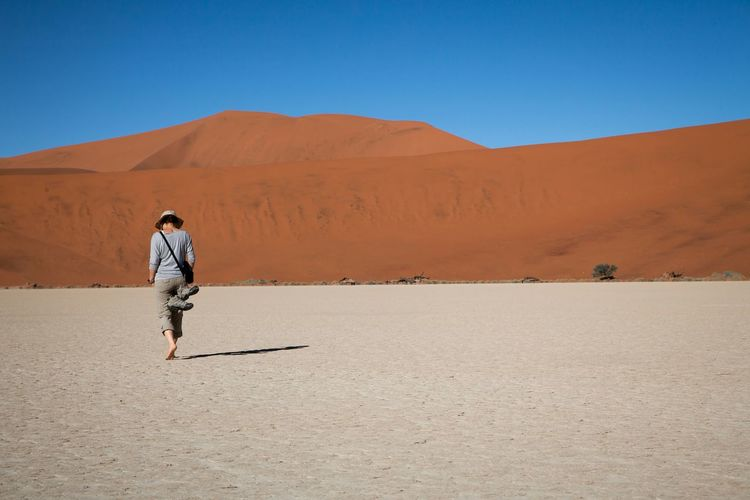 Woman standing on arid landscape
