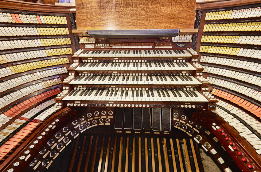 Largest Organ in America. Architecture Arts Culture And Entertainment Building Ceiling Classical Style High Angle View In A Row Indoors  Large Group Of Objects Music Musical Equipment Musical Instrument No People Order Organ Pattern Piano Piano Key Pipe Organ Repetition Shelf Wood - Material