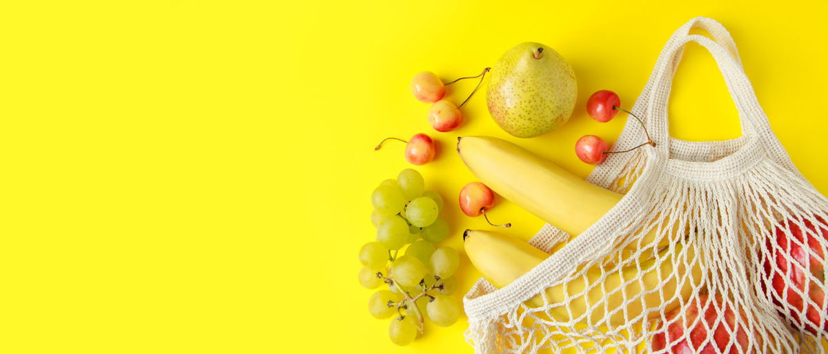 Close-up of fruits against yellow background