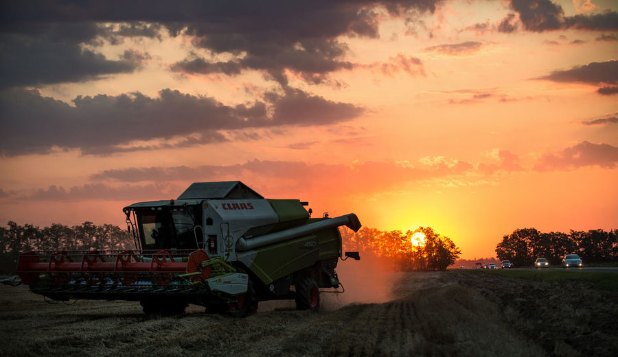 Russia, Krasnodar region, agriculture, wheat, harvest Atmosphere Atmospheric Mood Cloud Cloud - Sky Cloudscape Cloudy Community Dramatic Sky Human Settlement Light Moody Sky No People Orange Color Outdoors Overcast Residential District Sky Storm Cloud Sunset Weather
