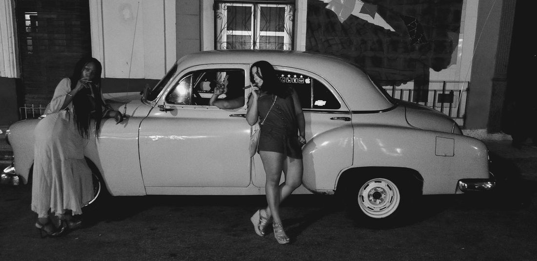 Havana Nights #nightout #vintage #photography #travelphotography #havanacuba #makingmemories #latransportacion #cohibacigars Car Transportation Mode Of Transport Land Vehicle Women Outdoors Togetherness Adults Only Standing