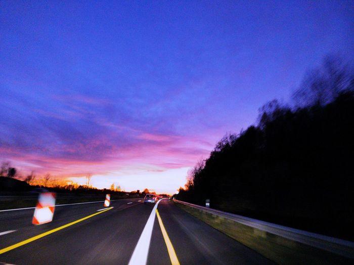 Sunset Autobahn Road Sky Dividing Line Asphalt Yellow Line White Line Highway vanishing point