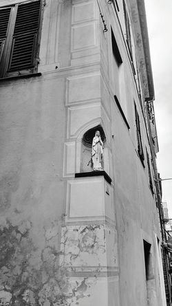 Albenga Arch Architecture Balcony Building Building Exterior Built Structure City Day Exterior Façade House Italy Low Angle View Madonna No People Old Outdoors Religion Residential Building Residential Structure Sky Sunlight Window