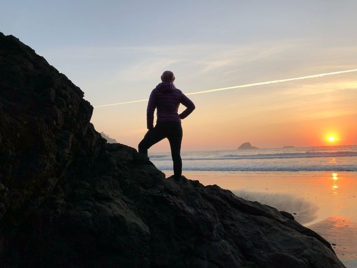 Super woman sunet Rock - Object Sunset Full Length Nature Real People Sea Leisure Activity Beauty In Nature Lifestyles Sky One Person Water Standing Silhouette Scenics Healthy Lifestyle Outdoors Exercising Beach
