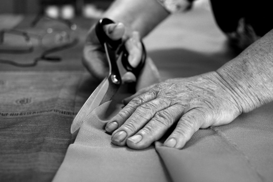 Dressmaker A Helping Hand Adult Close-up Day Dressmaker Dressmaking Expertise Focus On Foreground Human Body Part Human Finger Human Hand Indoors  Occupation One Person People Real People Senior Adult Skill  Working