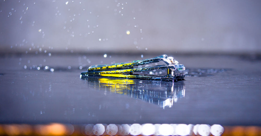 Close-up of ship floating on water