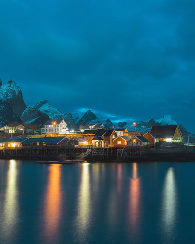Find more travel inspiration at http://www.instagram.com/simonmigaj Lofoten Lofoten Islands Norway Norge Mountains Dusk Reflection Sakrisøy Sakrisoy Reine Sky Architecture Built Structure Standing Water Evening Coast Waterfront