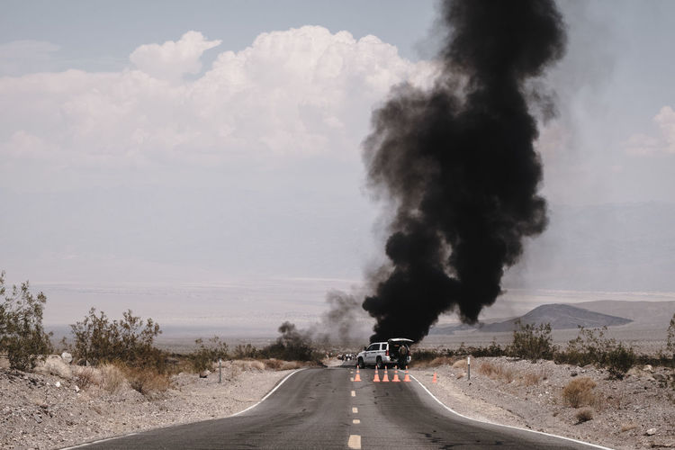 Smoke emitting from car on road