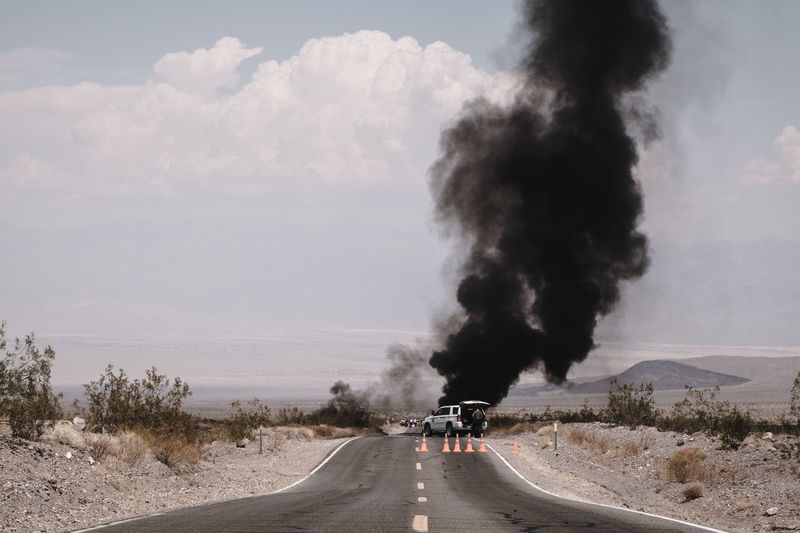 Death Valley Death Valley National Park Emergency Explosion Cloud - Sky Day Explosive Fire Land Vehicle Landscape Men Motorcycle Nature Outdoors People Police Power In Nature Ranger Real People Road Road Closed Sky The Way Forward Transportation Tree