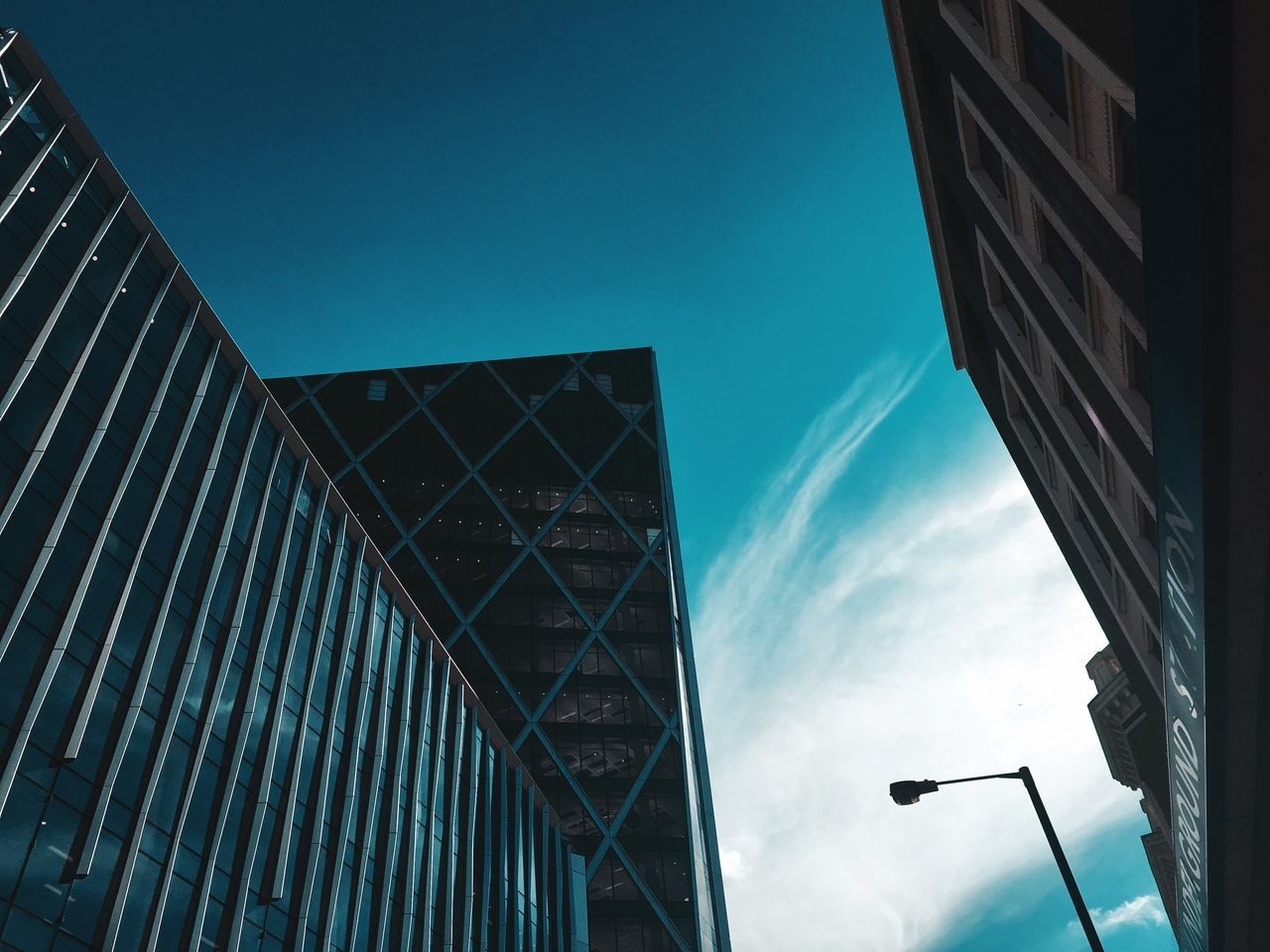 built structure, architecture, building exterior, sky, low angle view, building, city, no people, nature, cloud - sky, modern, blue, day, office, outdoors, glass - material, office building exterior, window, reflection, business, skyscraper
