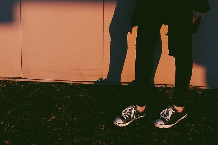 Low Section Human Leg Standing People Human Body Part Day Close-up Illuminated Sunset Orange Wall EyeEmNewHere Phone Photography Grunge Outdoors Chuck Taylor