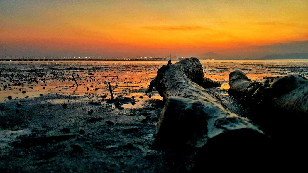 This photo was rejected once, re-edit and repost😁😁😁 Penang Bridge Penang First Bridge Sunset Sea Beach Scenics Horizon Over Water Nature Sky Water Beauty In Nature Tranquility Rock - Object Outdoors Tranquil Scene No People Sand Wave Travel Destinations Day Malaysia