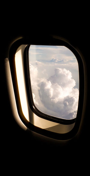 Cloudy sky seen through airplane window