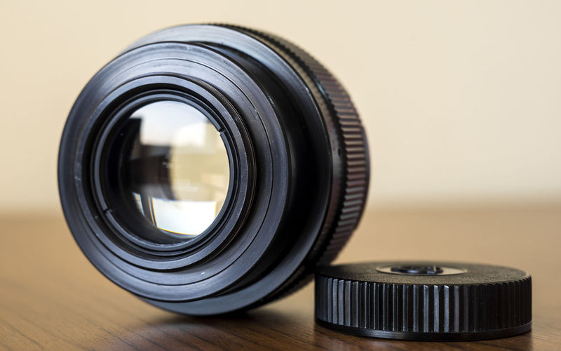 Close-up of camera lens on table