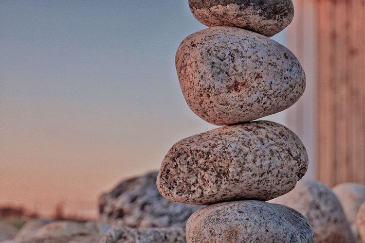Close-up of stone stack on rock