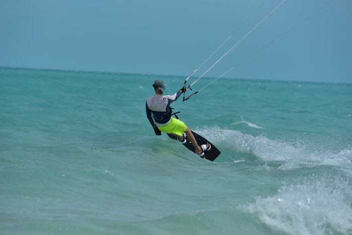 Adventure Aquatic Sport Athlete Carribean Sea Extreme Sports Kite Surfing Kiteboarding Leisure Activity Men Nature One Man Only One Person Outdoors Sea Skill  Sport Turks And Caicos Vacation Vacations Water Watersports Photography Young Adult