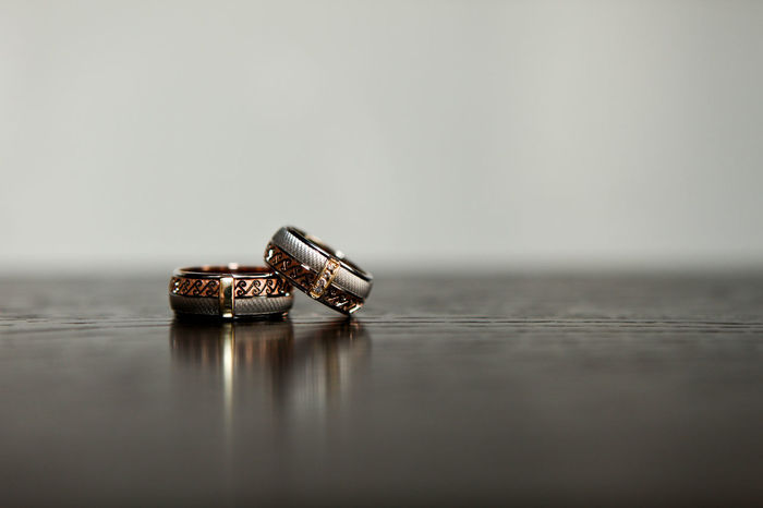 Two wedding rings threaded on the gray background Accessories Close-up Day Gold Indoors  Jewellery Jewelry No People Platinum Rings Silver  Table Wedding Rings