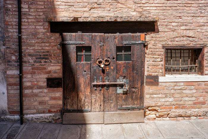 House facade in Venice, Italy. Façade House Facade Old Town Venice, Italy Architecture Brick Brick Wall Building Building Exterior Built Structure Closed Day Door Entrance Facade Building House House Facades Italy Latch Lock No People Old Outdoors Protection Safety Security Venice Wall Wood - Material