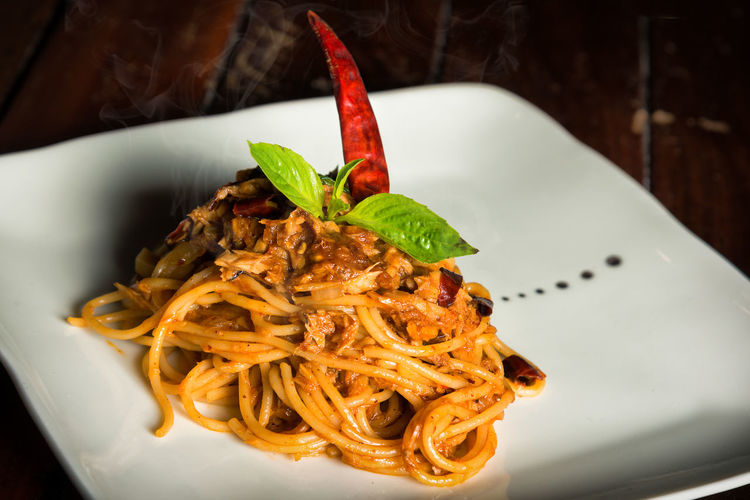 Spaghetti tuna on a white plate Close-up Eating Utensil Food Food And Drink Freshness Garnish Healthy Eating Herb High Angle View Indoors  Indulgence Italian Food Meal No People Pasta Plate Ready-to-eat Serving Size Snack Spaghetti Still Life Table Temptation Wellbeing