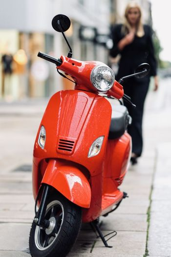 Red vintage motor scooter on street