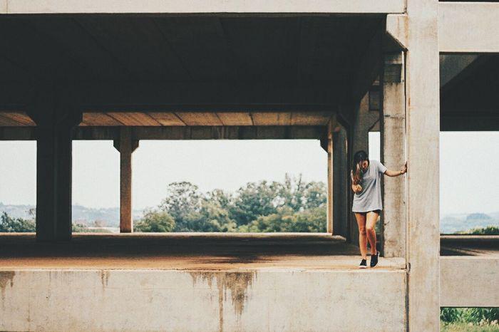 The Portraitist - 2016 EyeEm Awards people x concrete Canonphotography Canon 50mm Makemoreportraits Portrait Of A Woman Girl Power Eyeemphoto Minimalist Architecture Women Around The World The Secret Spaces
