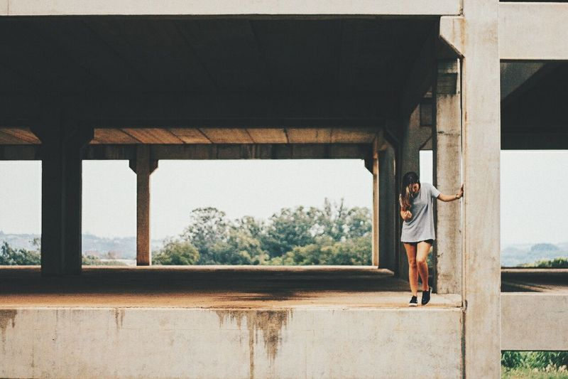 Full Length Of Woman Standing At Incomplete Building