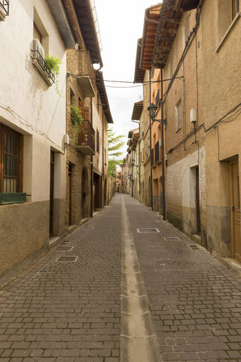 Puente La Reina Alley Architecture Building Exterior Built Structure City Cobblestone Day Navarra No People Outdoors Residential Building Sky Street The Way Forward Town Window