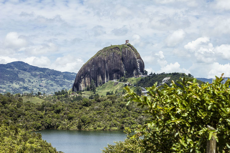 El penol de Guatape in all its glory. Colombia Overgrown PeñolDeGuatape Beauty In Nature Cloud - Sky Day Green Color Growth Guatape Mountain Nature No People Non-urban Scene Outdoors Plant Rich Life Scenics - Nature Sky Tranquil Scene Tranquility Tree Vibrant Color Water Waterfront