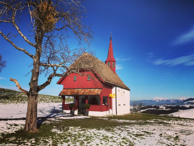Chapel in Switzerland Menzingen Zug Winter Church Chapel Architecture Built Structure Nature Outdoors Sky Day Building Exterior No People Tranquility Sunlight Place Of Worship Landscape Spirituality Mountain Scenics Snow Tree Blue Tranquil Scene Beauty In Nature