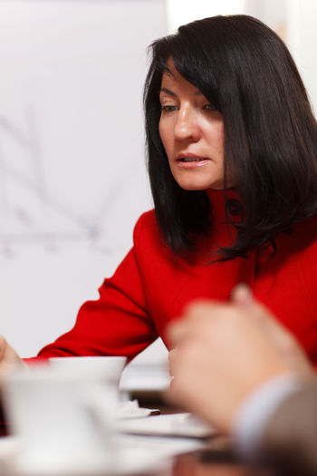 Beautiful Brunette Business Businesswoman Caucasian Coat Discussing Looking Down Meeting Office One Portrait Red Serious Woman Worried