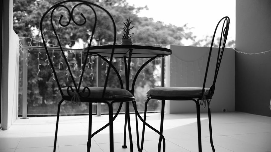 Balcony Balcony View Black & White Black And White Blackandwhite Blackandwhite Photography Day Fujifilm Metal Monochrome Nature No People Outdoor Furniture Outdoors Sky Tree
