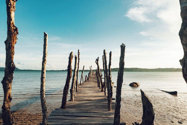 Backgrounds Seascape Wooden Bridge - Man Made Structure Day Outdoors Water Sea Nautical Vessel Beach Wood - Material Sky Horizon Over Water Wooden Raft Stilt House Raft Stilt Jetty Outrigger Rope Swing Wooden Post Pier Moored Calm Wood Paneling Railway Bridge Coast Harbor Dock Shore