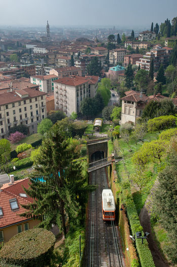 Travel Destinations Cityscape Outdoors Travel Mode Of Transportation Town No People Transportation High Angle View City Architecture Building Exterior Bergamo Italy Tram Funicular Funicular Railway Railroad Track Rail Transportation Train - Vehicle