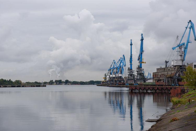 Cranes at Riga port Harbor Harbour Latvia Andrejosta Architecture Building Exterior Crane - Construction Machinery Crazy Outdoors Port River Sailing Ship Shipyard