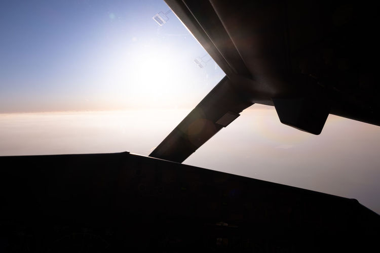 Silhouette of airplane flying in sky