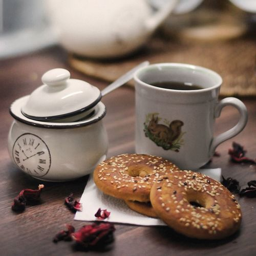 Close-up of donuts with coffee on table