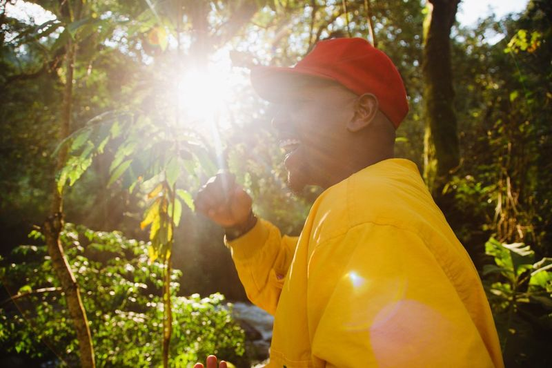 All smiles Plant Tree Nature Sunlight Men Real People Leisure Activity One Person Lifestyles Side View Lens Flare Growth Waist Up Adult Young Men Casual Clothing Outdoors Forest Day The Portraitist - 2018 EyeEm Awards The Great Outdoors - 2018 EyeEm Awards