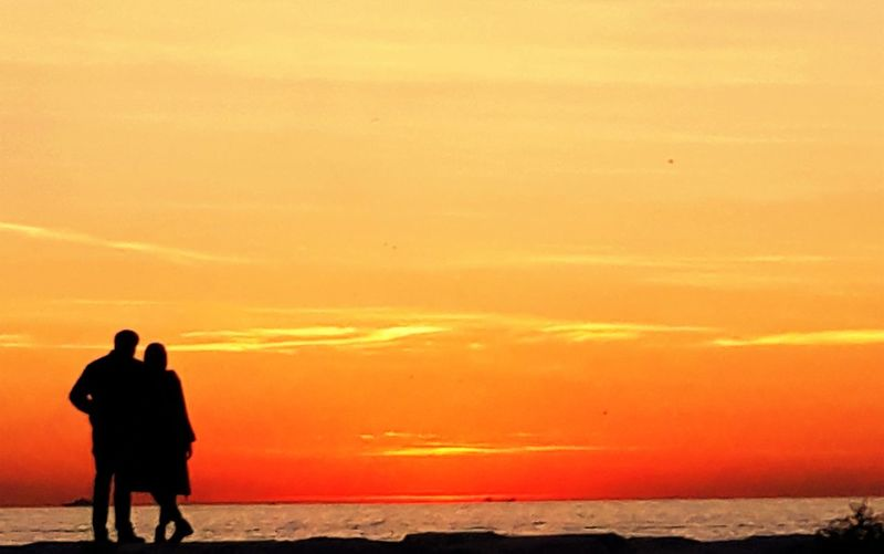 Sunset Beauty In Nature Sky Sea Orange Color Beach Water Two People Silhouette Standing Land Scenics - Nature Togetherness Leisure Activity Lifestyles Real People People Nature Couple - Relationship Horizon Over Water Outdoors Positive Emotion Love ♥