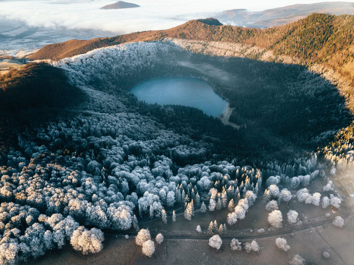 Aerial view of frozen trees and volcano lake.majestic sunrise in the mountains