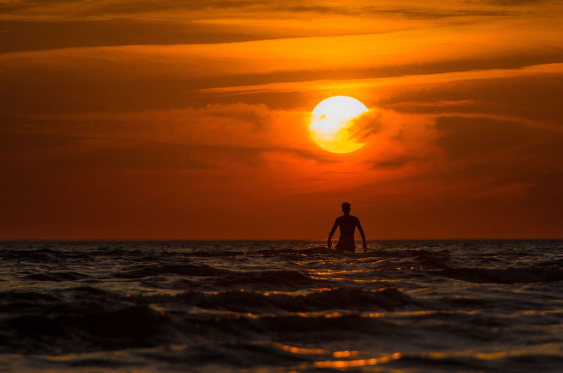 Sundown in Spitsino. Adventure Beach Beauty In Nature Horizon Over Water Lifestyles Man Men Nature One Person Orange Color Outdoors Real People Sea Sun Sunset Water Wave First Eyeem Photo