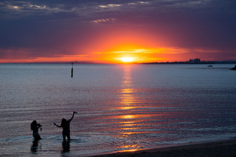 Friends St. Kilda Beach Beach Beauty In Nature Cloud - Sky Friendship Horizon Over Water Leisure Activity Lifestyles Melbourne Men Nature Orange Color Outdoors People Real People Scenics Sea Silhouette Sky Sun Sunlight Sunset Vacations Water