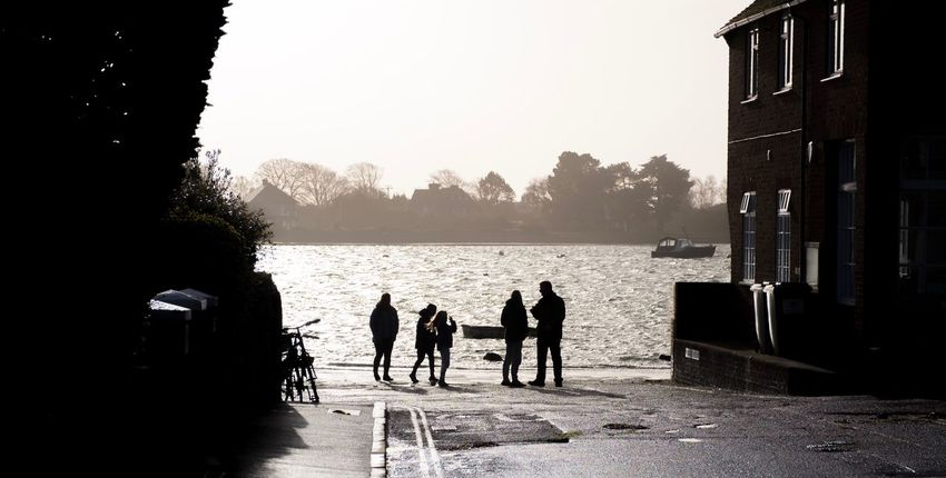Windy morning at high tide Water Built Structure Silhouette Building Exterior Leisure Activity Day Architecture Sunlight Outdoors Sea Men Togetherness Real People Nautical Vessel Adult People Sky