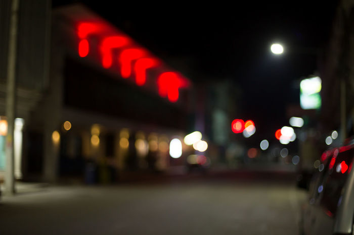 Architecture Background Bokeh Bokeh Building Exterior City City Street Communication Defocused Illuminated Light Lighting Equipment Mode Of Transportation Neon Night No People Red Road Sign Street Text Transportation Travel