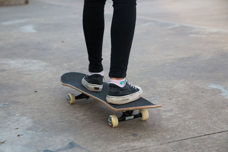 Low section of person standing on skateboard